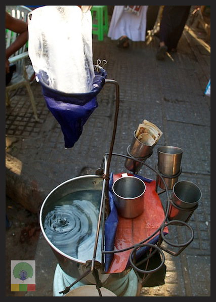Drinking cold water in the streets of Myanmar