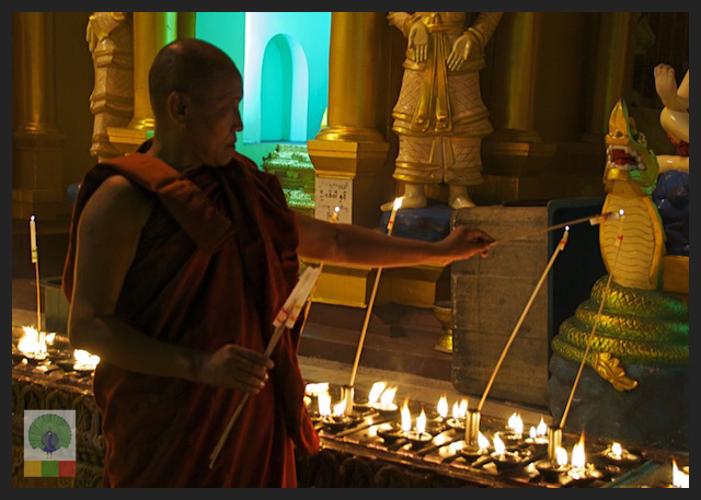 Shwedagon Pagoda by night - Monk Lighting Candles - Yangon - Myanmar (Burma)