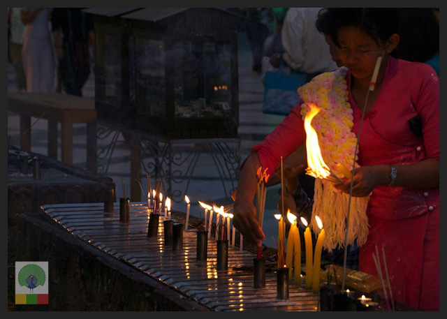 Shwedagon Pagoda by night - Worshipper Lighting Candles - Yangon - Myanmar (Burma) 3