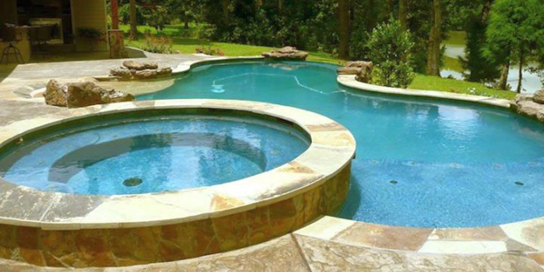 Pool with spa designs large freeform pool with round jacuzzi for Pool jacuzzi design