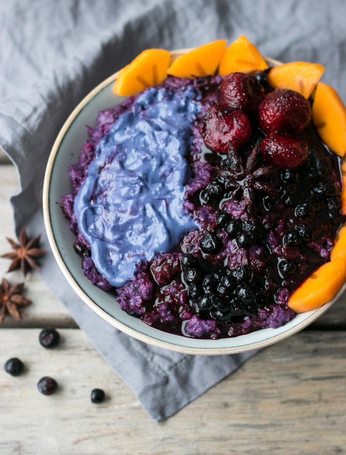 Blueberry porridge with berry compote and berry cashew cream