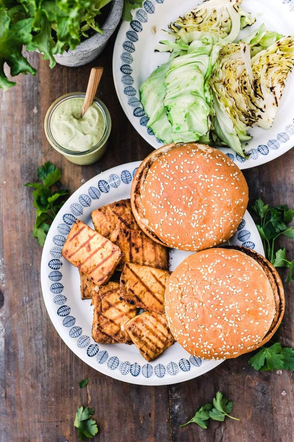 Grilled vegan caesar salad tofu burger with garlic oil