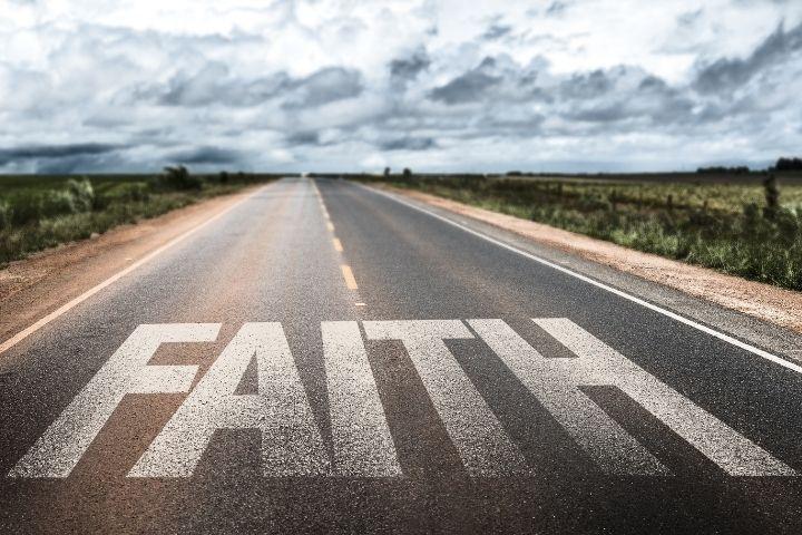 """The word """"Faith"""" written on a road"""