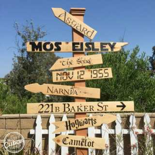Outdoor Movie Theatre directional signs for locations such as 221 B Baker Street, the Shire, Camelot, Narnia and Asgard