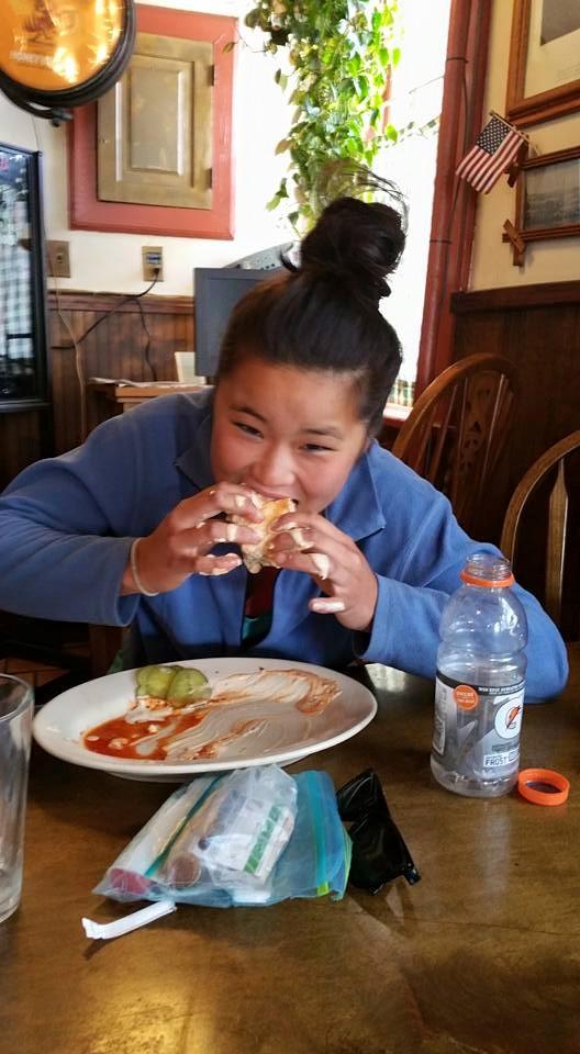 Free Ball enjoying a very messy burger