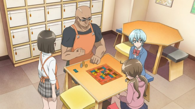 The three main characters playing a game of Marrakech