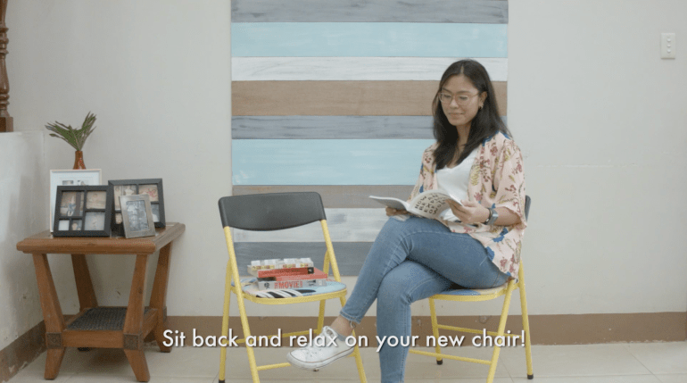 Woman relaxing in her new chair