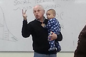 photo of professor holding student's baby