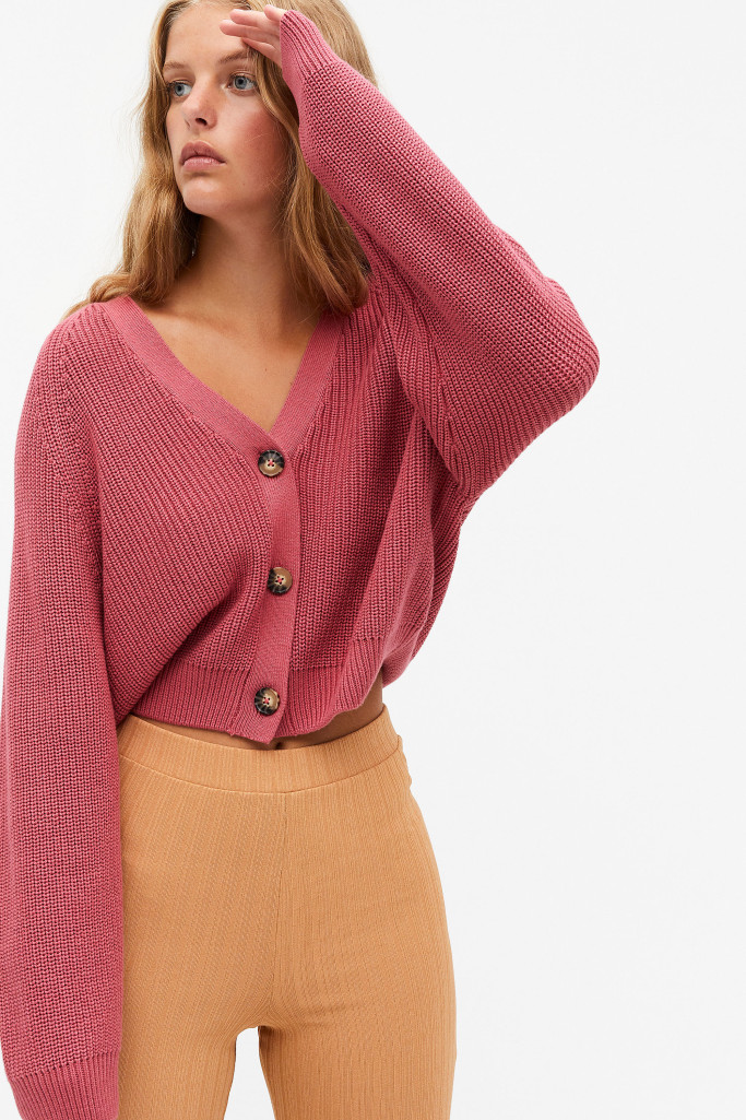 A model wearing a pink knitted cardigan