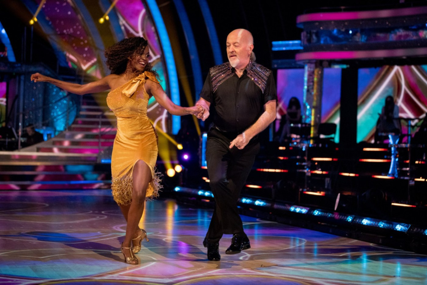 For use in UK, Ireland or Benelux countries only Undated BBC handout photo of Bill Bailey and Oti Mabuse, during the launch show for the BBC1 dancing contest, Strictly Come Dancing. PA Photo. Issue date: Saturday October 17, 2020. See PA story SHOWBIZ Strictly. Photo credit should read: BBC/PA Wire NOTE TO EDITORS: Not for use more than 21 days after issue. You may use this picture without charge only for the purpose of publicising or reporting on current BBC programming, personnel or other BBC output or activity within 21 days of issue. Any use after that time MUST be cleared through BBC Picture Publicity. Please credit the image to the BBC and any named photographer or independent programme maker, as described in the caption.