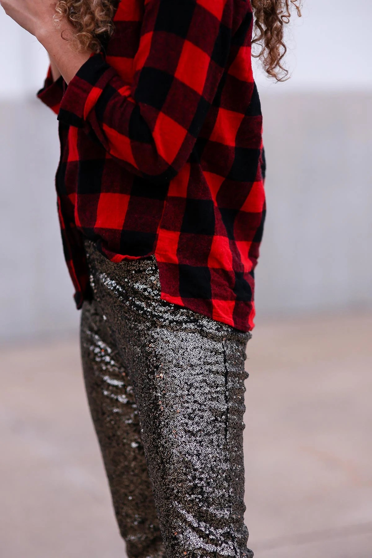 holiday outfits featuring sequin pants and a buffalo plaid shirt