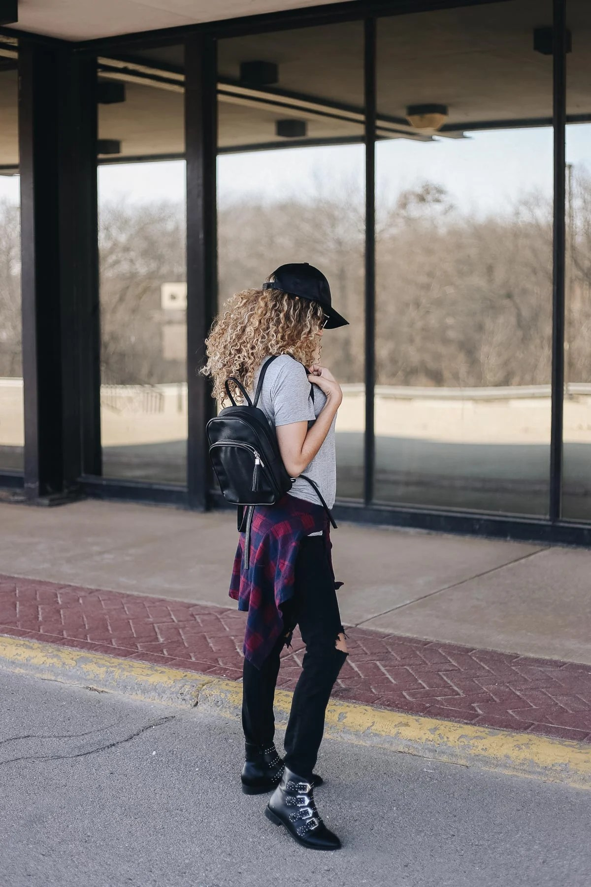 comfy airport outfit with a basic tee and ankle boots
