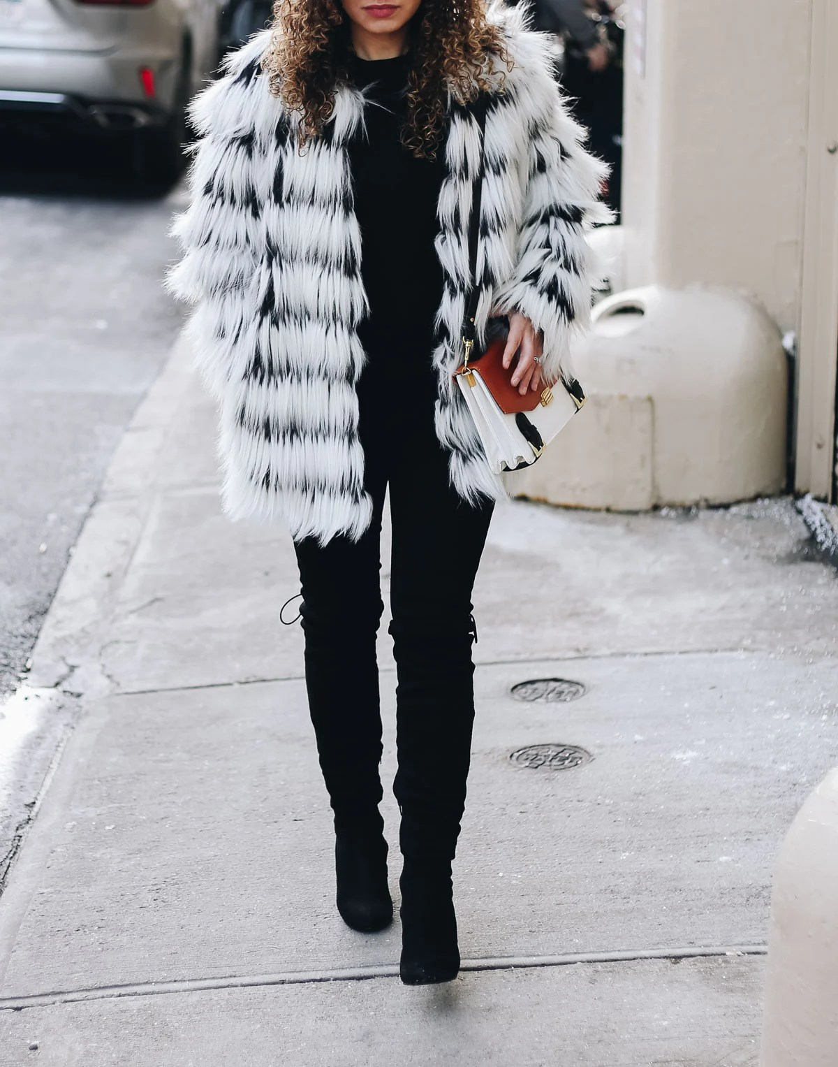 Faux fur statement coat to complete your winter travel outfit!