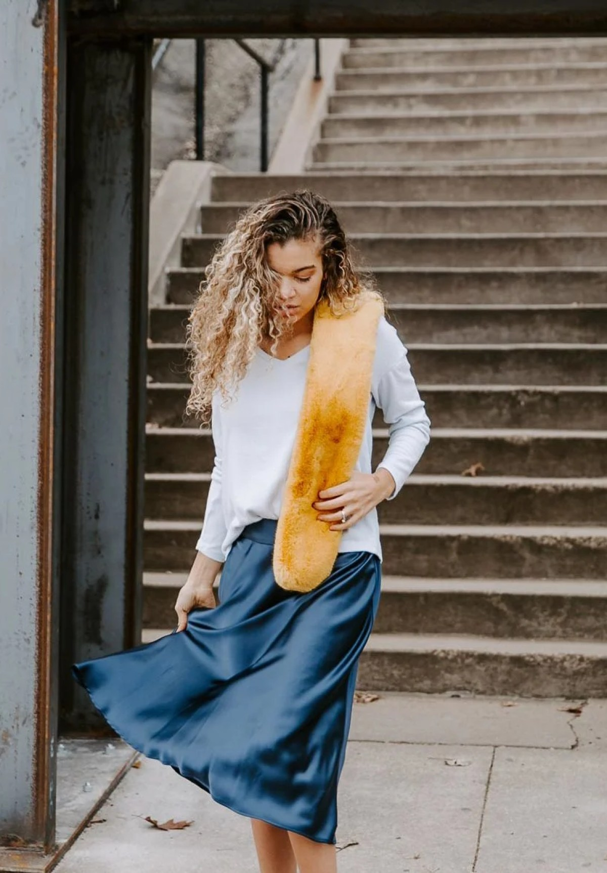 The perfect blue satin skirt outfit with a sweater. Perfect skirt and sweater combo!