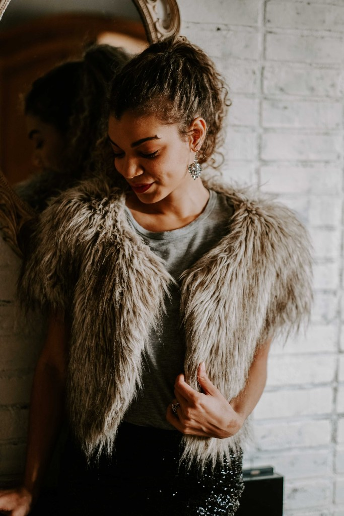 faux fur vest for a holiday outfit idea