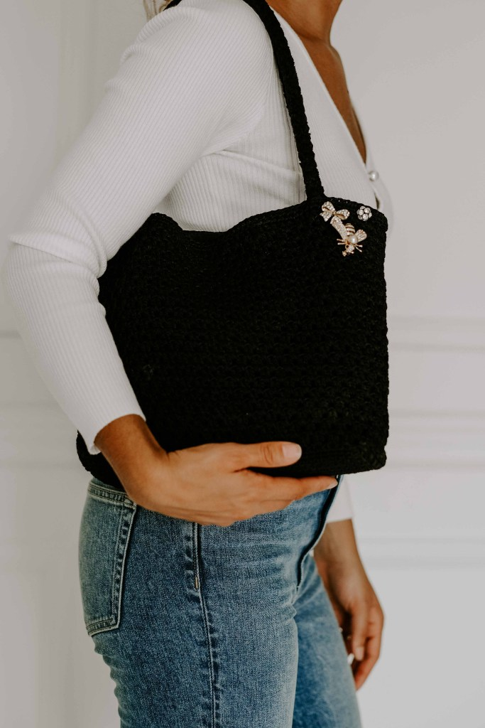 brooches on purse