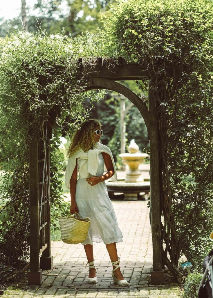 white dress in a european courtyard
