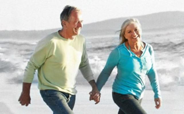 Elderly couple walking on the beach