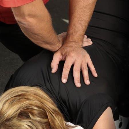 Gonstead Chiropractor Treating Patient