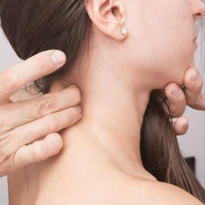 Chiropractor assessing upper neck of female
