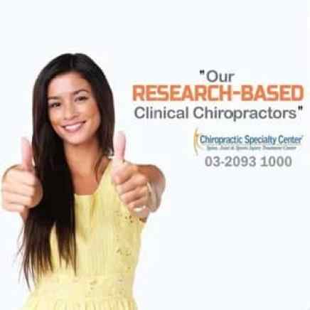 Female giving chiropractic care two thumbs up
