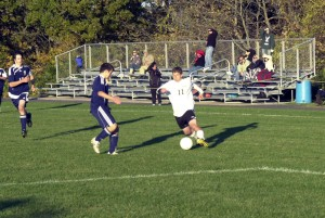 Woodland's Calvin Day (right) plays a ball deep into Immaculate territory.