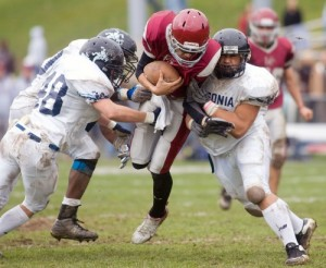 Naugatuck quarterback Tyler Conklin is tackled by a host of Ansonia defenders, including Tyler Wood (48) and Bobby Kinnebrew (40), in the Hounds' 56-20 loss to Ansonia Thanksgiving morning at Veterans Field. The loss was Naugy's eighth-straight to Ansonia on Turkey Day.