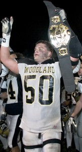 Stankus (pictured after Woodland won the Class SS state title in 2005) and former teammates Katchmar and Krakowski have returned to the Woods in hopes of helping the Hawks wear another championship belt.