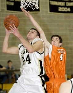 Brian Spickle scored 16 points and pulled down 12 rebounds against the Indians to help Woodland climb above .500.