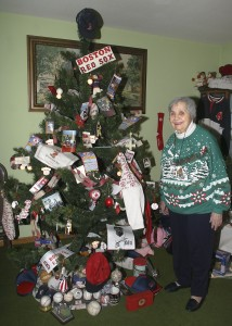 Livia Keith stands next to her Boston Red Sox Christmas tree at her home in Beacon Falls Friday. Keith is the town's first Christmas mayor for the month of December.