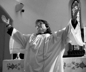 Naugatuck resident Linda Cray, 45, practices a hymn in the sanctuary of St. Michael's Church, where she is a member of the choir.
