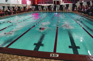 Naugatuck's Dalton Fennell (third lane, from left) pulls away from the field en route to victory in the 50-yard freestyle with a time of 22.84 seconds.