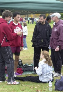 "Hanley (far right), pictured at the 2008 New England cross country championships with, from left, assistant coach Matt Basile, Hrezi, Hrezi's father, Fuad, and Moriello (seated), calls his top runners ""students of the sport."""