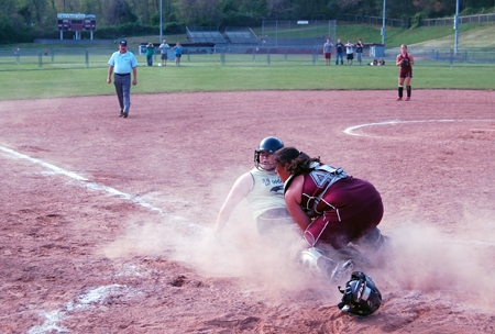Woodland's Aubrey Roulanaitis got caught in a rundown in the third inning but eventually slid safely under the tag of Naugatuck catcher Sydney Cotto to score the Hawks' third run in a 6-2 victory Saturday.