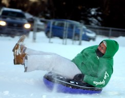 Isa Ortiz sleds at Fairchild Park after the snow storm Dec. 27.