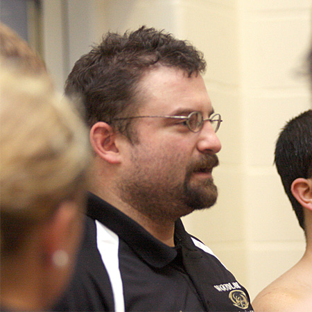 Coach Tom Currier talks to his team after the meet.