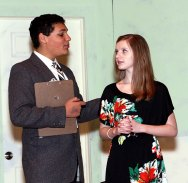 "Freshman Preston Bogan, left, playing Dr. Wells, comforts junior Erica Blasko, playing Juliet, during the drama club's rehearsal of ""Ladies Sigh no More."""