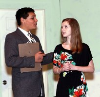 "Freshman Preston Bogan, left, playing Dr. Wells, comforts junior Erica Blasko, playing Juliet, during the drama club's rehearsal of ""Ladies Sigh no More."""