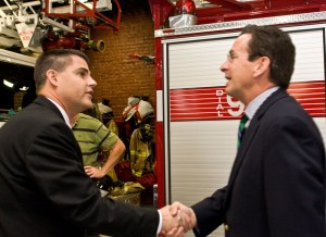 Naugatuck Mayor Bob Mezzo, left, greets then gubernatorial candidate Dannel Malloy at the Naugatuck Fire House in November.