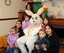 From left, Jordyne Almeida, 5, Ivone Almeida, Courtnie Almeida, 8, Shelbe Almeida, 13, Taylor MacDonald, 4, Karla MacDonald, and Ryan MacDonald, 2, pose for a picture with the Easter Bunnry at the Naugatuck Parks and Recreation Department's Easter Village April 22.