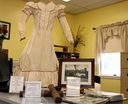 Historic artifacts, including a dress worn at the dedication of the Depot Street Bridge in 1935 and a photograph of the old wooden bridge were on display at the Beacon Falls Senior Center following the dedication of the newly repaired Depot Street Bridge April 8.