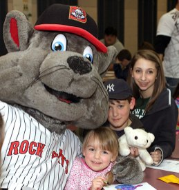 From left, Gracie Roberts, 3, Luke Roberts, 10, and Mariah Miklus, 13, pose with Rocky of the New Britain Rock Cats.