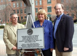 From left, Beacon Falls Selectman Dominic Sorrentino, First Selectman Susan Cable, and Selectman Michael Krenesky pose with the plaque commemorating the rehabilitation of the Depot Street Bridge April 8.