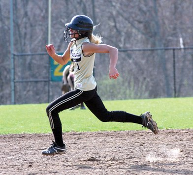 Woodland's Lindsay Boland sprints for third on her way to an inside the park homerun on Monday versus Naugatuck. The Hawks topped the 'Hounds 15-8. -LARAINE WESCHLER