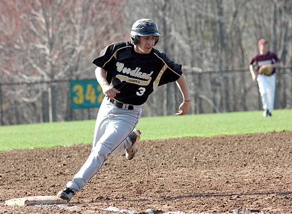 Woodland's Jake Pinho rounds third base on Monday versus Naugatuck. The Greyhounds defeated the Hawks 4-2. -LARAINE WESCHLER
