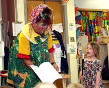 Leah Feeney, right, is amazed by the magic of Sparkles the Clown. Sparkles performed for the students at Tender Years Preschool May 13.