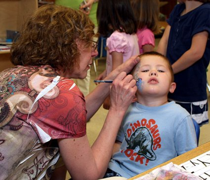 Local artist Nancy Haack paints a spider on Taydan Winters, 4, a Headstart student at Prospect Street Preschool. Haack donated her time talent to give all the Headstart students a special treat. She will also give free face painting to Headstart students at her Duck Day booth.