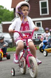 Abigail Brink peddles around the parking lot of Tender Years Preschool in Naugatuck during the annual Trike-a-Thon May 20.