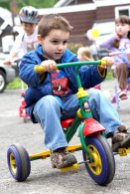 Justin Perriera peddles around the parking lot of Tender Years Preschool in Naugatuck during the annual Trike-a-Thon May 20.