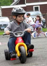 Matt DosSantos peddles around the parking lot of Tender Years Preschool in Naugatuck during the annual Trike-a-Thon May 20.